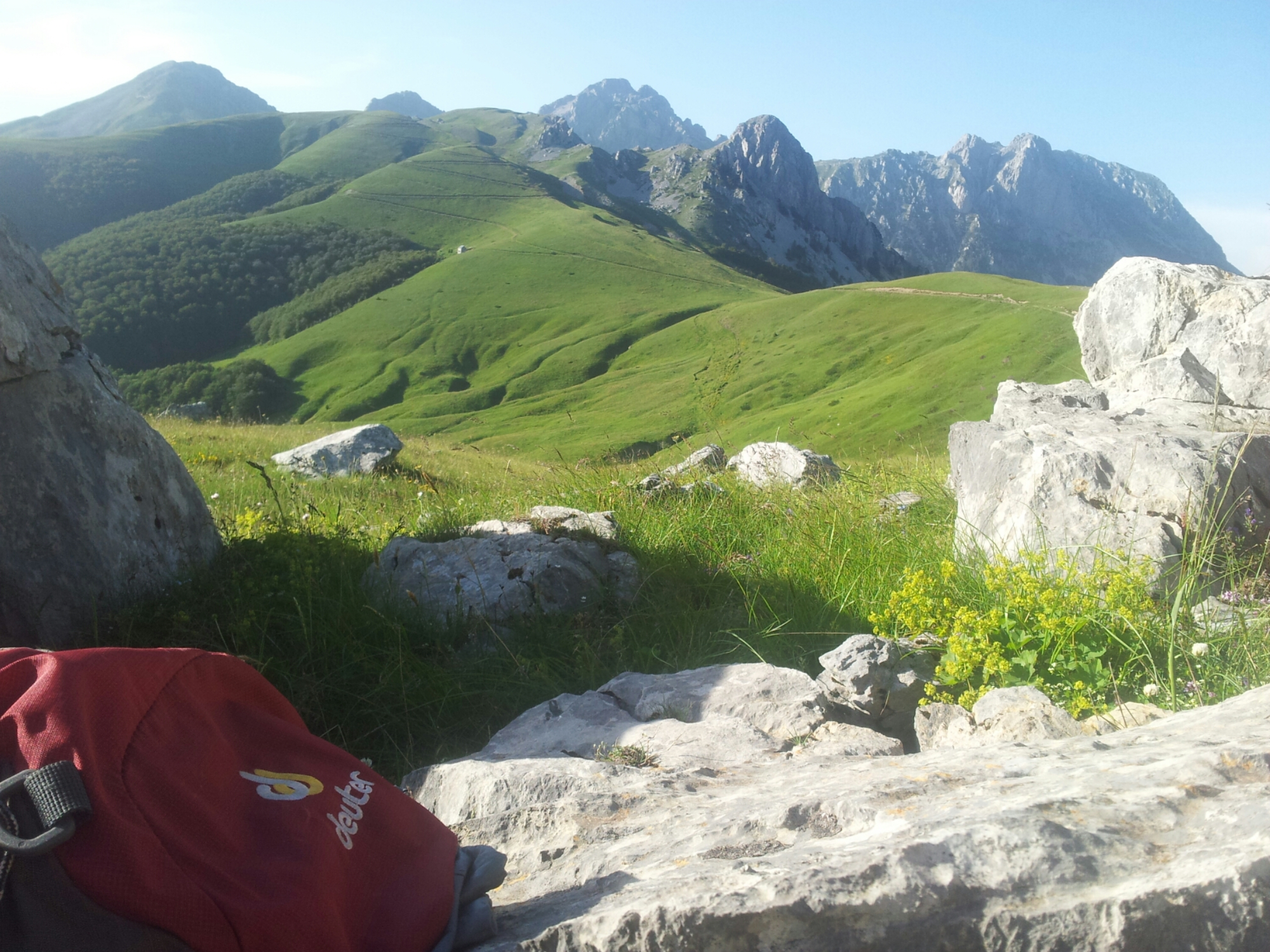 Green_mountains_and_Red_Deuter_backpack_Crvena_Perla