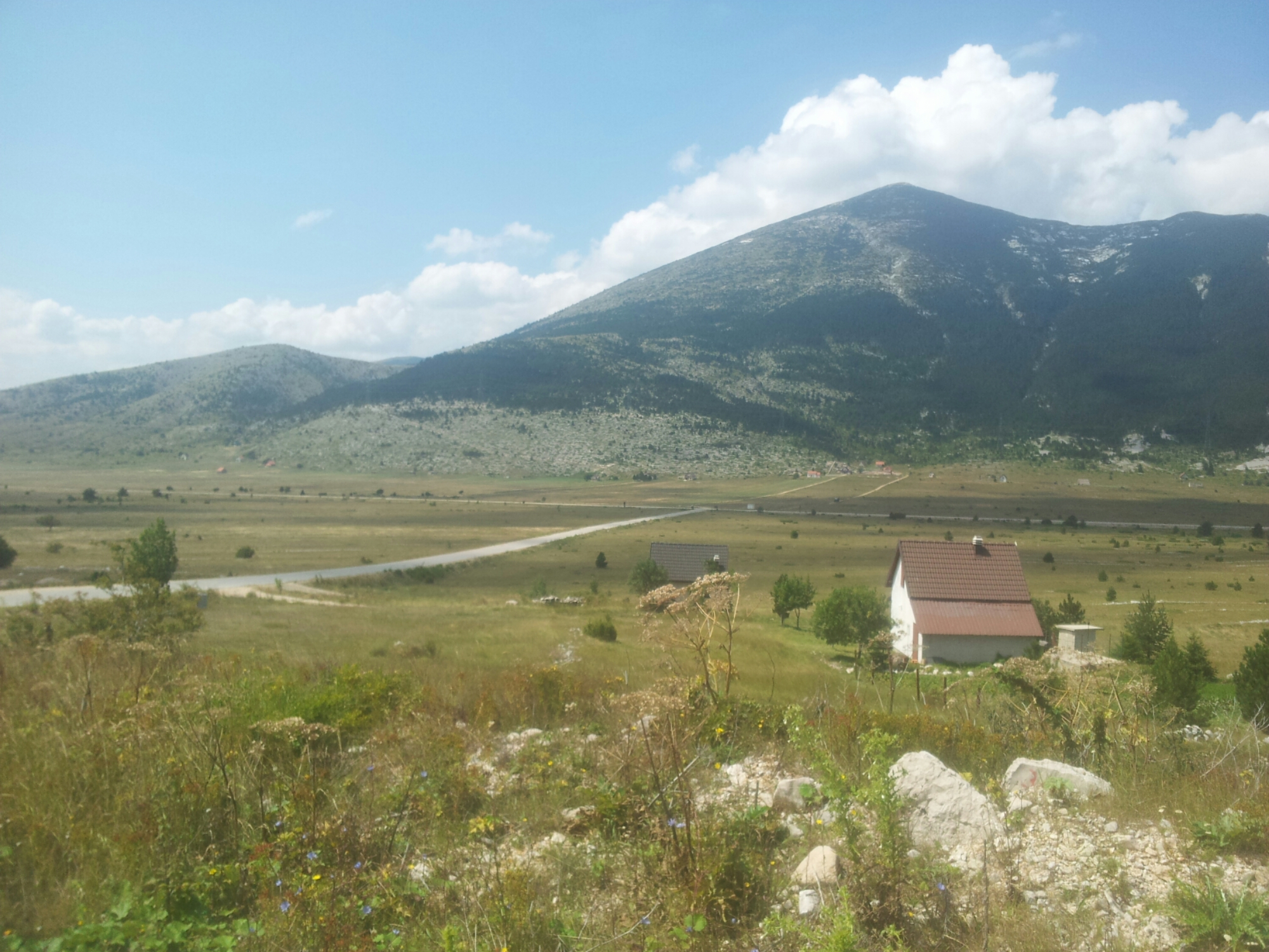 Blidinje_NP_Valley_Vran_with_clouds_summer_2016