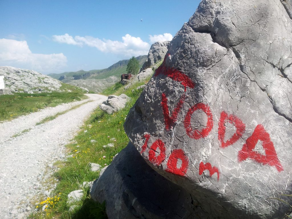 Hiking Via Dinarica White Trail through the Mountains of Montenegro | A makadam section, with water :)