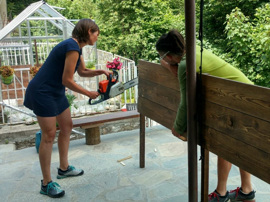 Working in the garden   Cutting wood for the raised gardenbed at Ski Hut Gorica